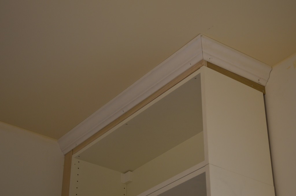 Cabinets got crowned st paul haus for Attaching crown molding to kitchen cabinets